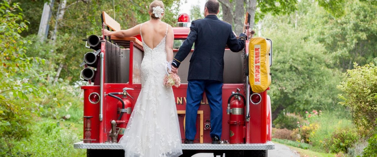 Bride and groom on back of Lincolnville Maine fire truck